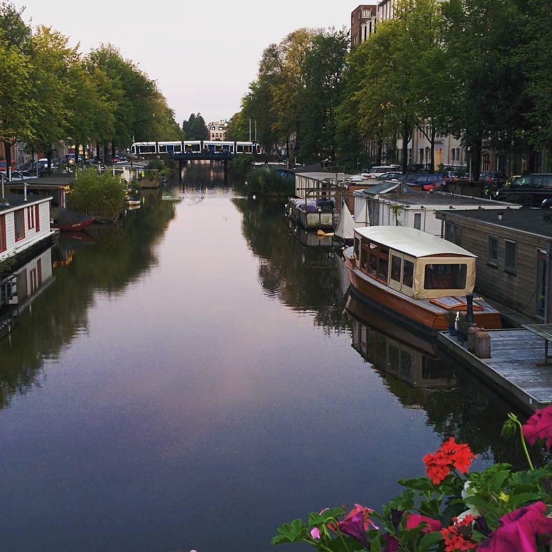 #beautiful #Amsterdam #sunny #gracht #boats #houseboats #flowers #tram